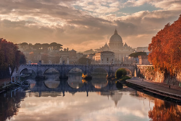 Autumn sunset in Rome long River Tiber with Saint Peter dome and Sant'Angelo Bridge