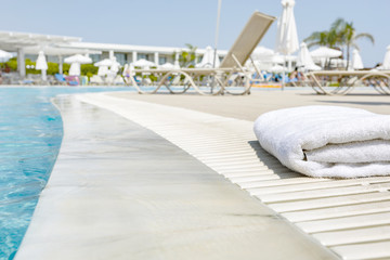 a towel at the pool on a beautiful vacation day