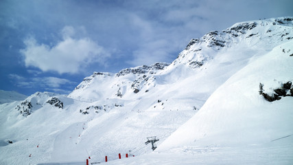 Panoramic alpine winter landscape of slopes, off piste skiing, chair lifts, in the highest French resort of Val Thorens, Les Trois Vallees .