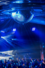 Disco ball with bright rays, night party or concert background