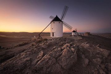 Don Quixote windmills at sunset. Famous landmark in Consuegra, Toledo Spain.