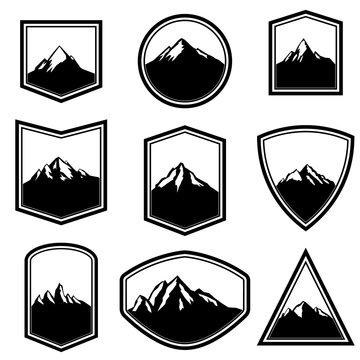 Set of empty badges with mountains. Design elements for logo, label, emblem, sign.