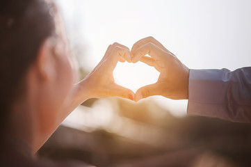 Day of Love of Young Hand with the heart of two people.