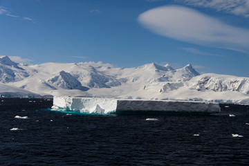 Antarctic landscape with iceberg
