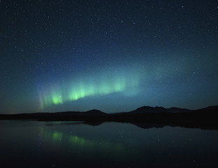 Aurora borealis over lake