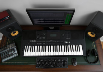 Home recording studio with professional monitors and midi keyboard. Top view.