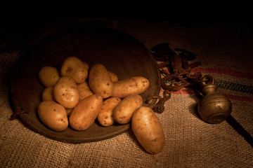 potatoes with ancient steelyard (light painting technique)
