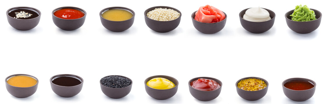 Sauces set in brown bowls isolated on white background.