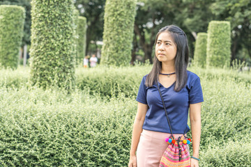 Portrait of a asian woman with  in the park, Portrait beautiful asia girl having happiness on  nature background. copy space for text. holiday concept.