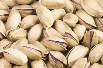 Green fresh pistachios as texture.