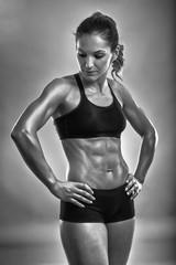 Fitness woman posing in studio