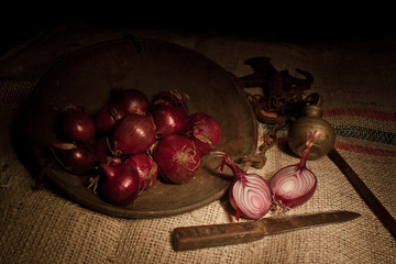 red onions with ancient steelyard  (light painting technique)