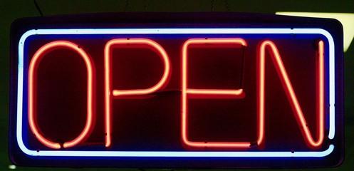 Neon open sign on black