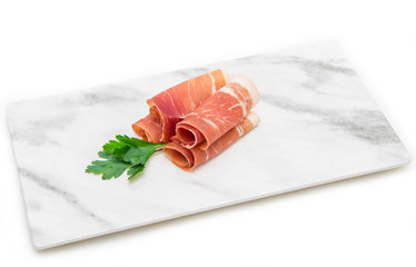 marble dish with raw ham slices