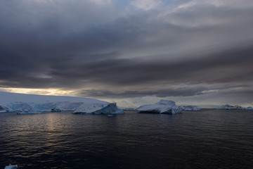 Antarctic landscape with sea and mountains