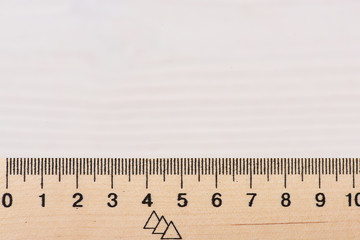 Wooden ruler close up on white background.