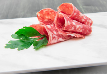 marble dish with salami slices
