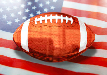 American football ball with flag background