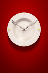 a dish clock on red background