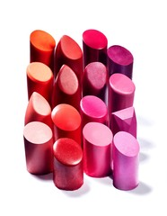 Pink and red lipsticks on white background