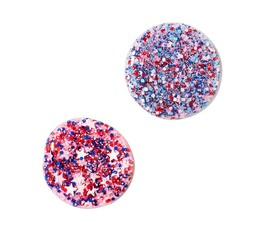 Two circles of pink and blue liquid cosmetics with glitter and star shapes
