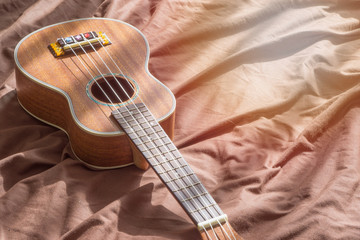 Close up ukulele on wooden background., copy space for text. music concept. beautiful concept.