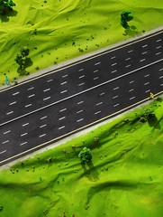Miniature model of empty highway and green landscape