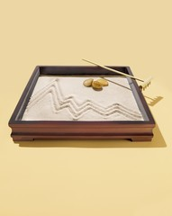 Zen garden with sand and rocks in box