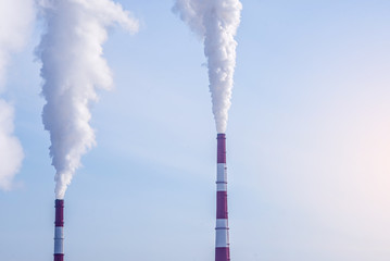 Smoking pipes of thermal power plant emitting carbon dioxide in the atmosphere. Concept of environmental pollution