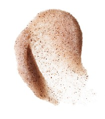 Smeared exfoliating skin scrub on white background