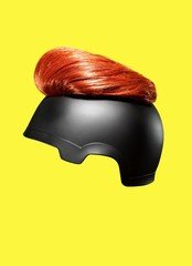 Helmet hair toupee against yellow background