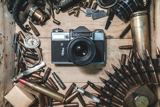 wooden box with vintage camera, bullets for automatic weapon, conceptual expression of the power of press, military journalist, consolidated independent press, top view