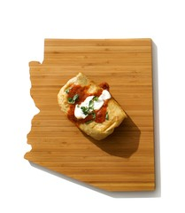 Burrito on wooden cutting board