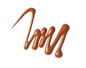 Squiggle of brown liquid cosmetics on white background