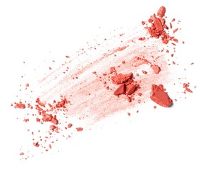 Smeared pink powdered cosmetics on white background