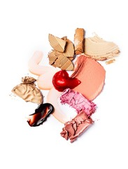 Smeared beige, pink and red cosmetics on white background