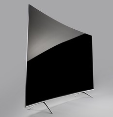 Black curved flat screen television on gray background