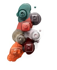 Overhead view of nail polish with spilled liquid bottles