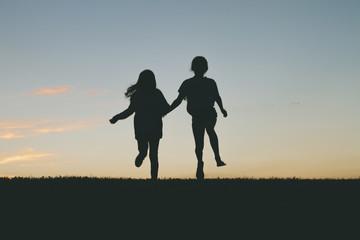 Girls Hopping Together