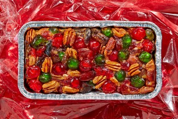 Top view fruit cake on red plastic background