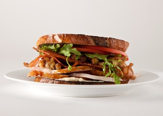 Close up of bacon, lettuce and tomato sandwich served plate