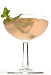 Close-up cocktail with mint garnish on white background