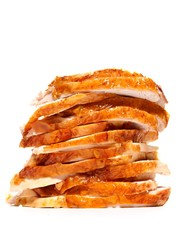 Stack of chicken slices on white background