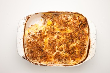 Top view baked casserole on white background