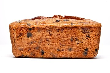 Fruitcake loaf on white background