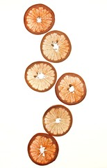 Citrus fruit slices on white background