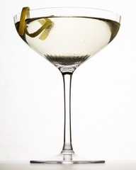 Low angle martini glass with lemon garnish on white background