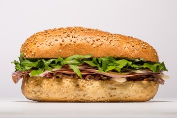 Meat hoagie sandwich with lettuce on white background