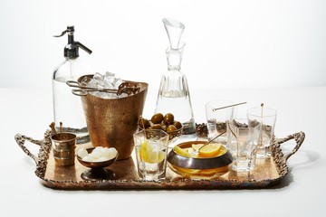 Glass decanter and metal bucket tray with bowls of olives,ions