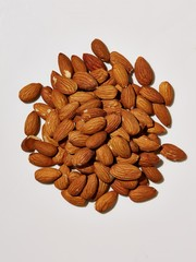 Pile of shelled almonds on white background